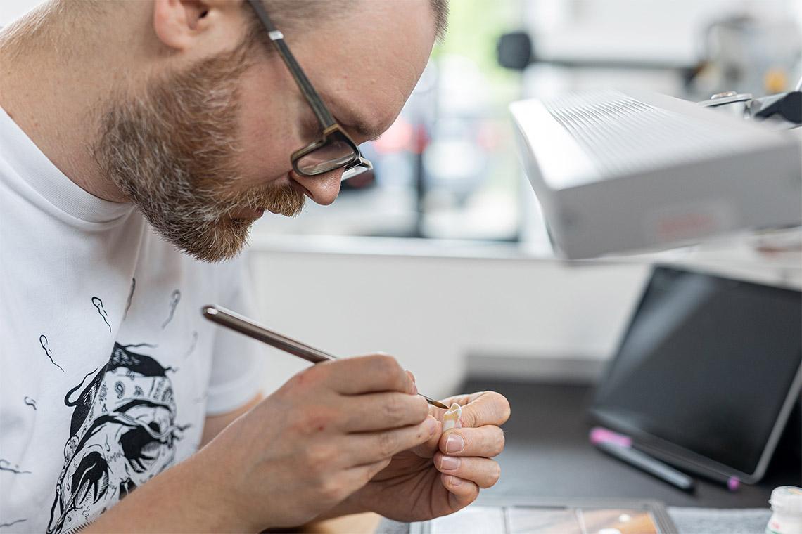 Master Dental Technician Stephan Juckel works with press ceramic