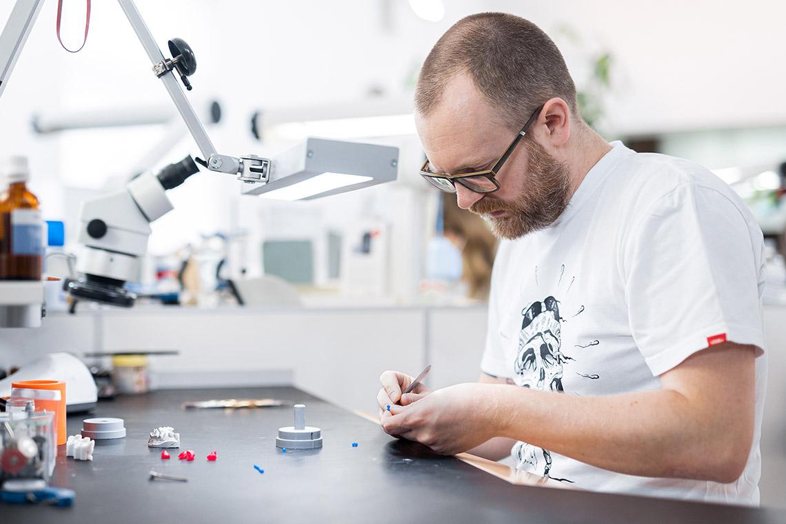 Master Dental Technician Stephan Juckel producing a wax model