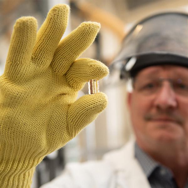VITA employee performing quality inspection of a VITA AMBRIA Press Ceramic pellet