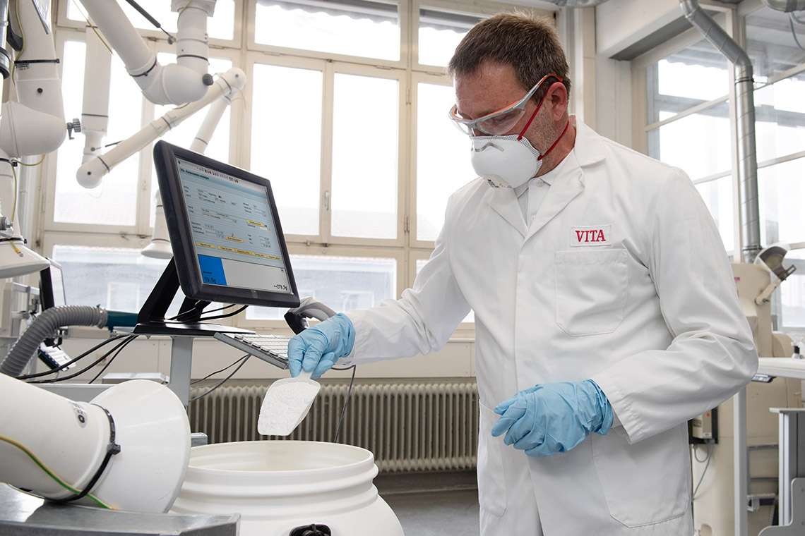 Raw materials for true-to-shade press ceramic are weighed out by a VITA employee