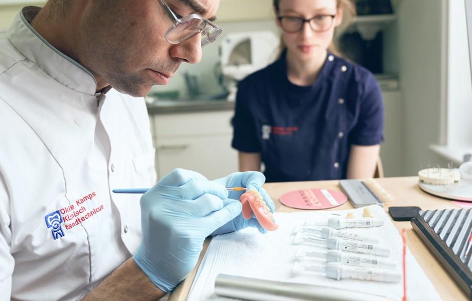 Dental technician Okke Kamps customises a denture base with VITA VM LC flow.